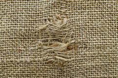 Burlap texture with a hole stock photography