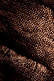 Burlap texture on Old wooden  table with sack cloth  in dark int Royalty Free Stock Photography