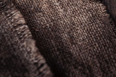Burlap texture on Old wooden  table with sack cloth  in dark int Royalty Free Stock Photo