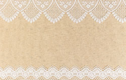 Burlap texture with white lace on wooden table background design Royalty Free Stock Image