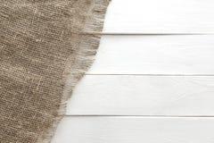 Burlap texture on white wooden background Royalty Free Stock Photo