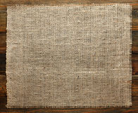 Burlap texture on wood Stock Images