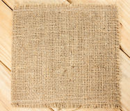 Burlap texture on wood background. Burlap texture on wooden background Royalty Free Stock Images