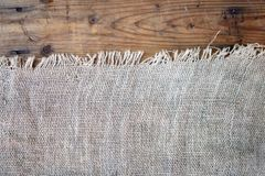 Burlap texture on wooden background. Burlap and wooden textures in close up Stock Photos
