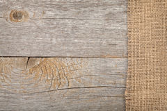Burlap texture on wooden table Royalty Free Stock Images