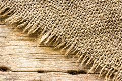 Burlap texture on wooden table Stock Photography