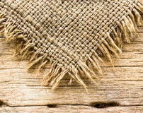 Burlap texture on wooden table Royalty Free Stock Image