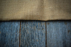 Burlap texture on wooden table Stock Image
