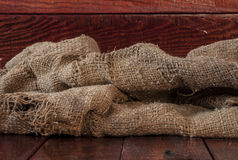 Burlap texture on wooden table Stock Photos