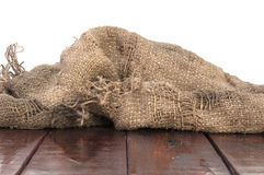 Burlap texture on wooden table Royalty Free Stock Photo