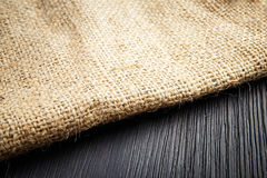 Burlap texture on wooden table background Stock Image