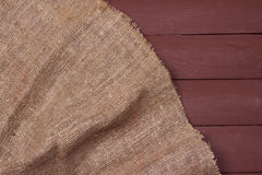 Burlap texture on wooden table background. Burlap texture on wooden table dark background Royalty Free Stock Images