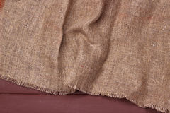 Burlap texture on wooden table background. Burlap texture on wooden table dark background Stock Images