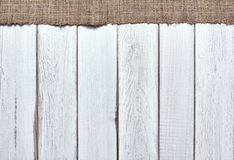 Burlap texture on wooden table background Royalty Free Stock Photos