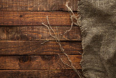 Burlap texture on wooden table Royalty Free Stock Photography