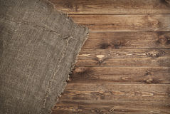 Burlap texture on wooden table background Stock Photography