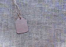 Burlap textured surface with a price tag Royalty Free Stock Photos