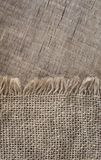 Burlap textureon a wooden background, rustic, christmas . Pattern  fabric textile. Texture background.  Royalty Free Stock Photos
