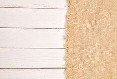 Burlap on a white board. Burlap and white wooden board Royalty Free Stock Images