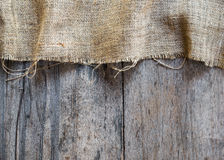 Burlap and wooden texture background Royalty Free Stock Photography