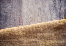 Burlap and wooden texture background Stock Image