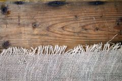 Burlap texture on wooden background. Burlap and wooden textures in close up Royalty Free Stock Photos