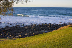 Burleigh Heads. A coastal scene of bliss in the late afternoon sun only minutes from the bustling metropolitan environment of Burleigh, on Australia's Gold Coast stock image