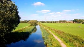 Burlescombe is a village and civil parish in the Mid Devon district of Devon, England. The Grand Western Canal ran between Taunton in Somerset and Tiverton in royalty free stock photo