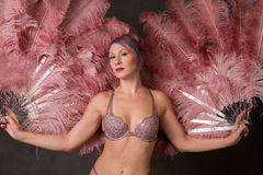 Burlesque dancer with big pink feather fans Royalty Free Stock Images