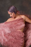 Burlesque dancer covered by fans Stock Image