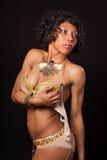 Burlesque dancer holding her bra Royalty Free Stock Image