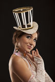 Burlesque dancer in white dress with hat Royalty Free Stock Image