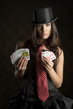 Burlesque girl with poker cards Stock Images