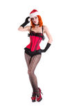 Burlesque girl in red corset and Santa Claus hat Stock Photos