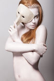 Burlesque. Naked Styled Woman Colored White with Venetian Mask Royalty Free Stock Photography