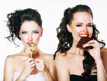 Burlesque. Parody. Couple of Women Sneers and showing a Fig. Portrait of Two Funny Women with sweets Royalty Free Stock Photography