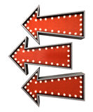 Burlesque Red Arrow Collections. A collection of 3 belle epoque era red vintage arrow signs lit by lightbulbs facing the same direction on an isolated dark Stock Photos