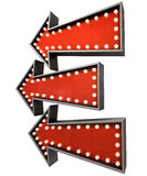 Burlesque Red Arrow Collections. A collection of 3 belle epoque era red vintage arrow signs lit by lightbulbs facing the same direction on an isolated dark Royalty Free Stock Photo