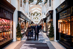 The Burlington Arcade in London. People shopping in The Burlington Arcade in London on November 21, 2013. The Arcade is a covered shopping street in London that Royalty Free Stock Image