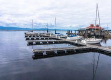 Burlington Boat House and Pier. Boathouse on the lake with pier and sail boats docked stock photography