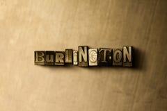 BURLINGTON - Nahaufnahme des grungy Weinlese gesetzten Wortes auf Metallhintergrund Lizenzfreies Stockbild