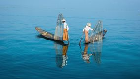 Burma, Inle Lake. The traditional way of fishing. Fishermen on boats with fish-traps stock footage