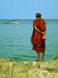 Burma. Monk Standing on Rock. Burma (Myanmar) Monk Standing on Coastline Rock stock image
