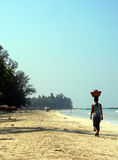 Burma (Myanmar) Female Beach Hawker. Burma (Myanmar) Beach Hawker / Trader carrying goods royalty free stock images