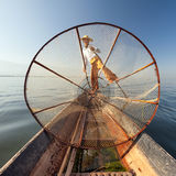 Burma Myanmar Inle lake fisherman on boat catching fish Stock Photos