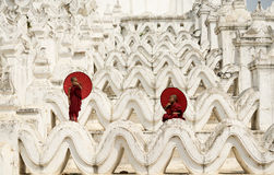Burma,The Novice monk. Holding red umbrella on the pagoda royalty free stock photo
