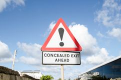 BURMARRAD,MALTA, 15 DECEMBER 2018 Concealed exit ahead sign under the blue sky and white clouds. Reflection on bus windows royalty free stock image