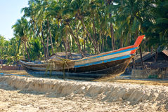 Burmese boat on the shore Stock Photo