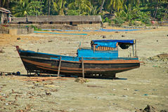 Burmese boat on the shore. Burmese traditional fishing village in the area of Ngapali on the bay of Bengal stock image