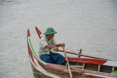 Burmese boatman at U Bein bridge, Taung Tha Man Lake in Amarapura, Mandalay, Myanmar. Stock Photos